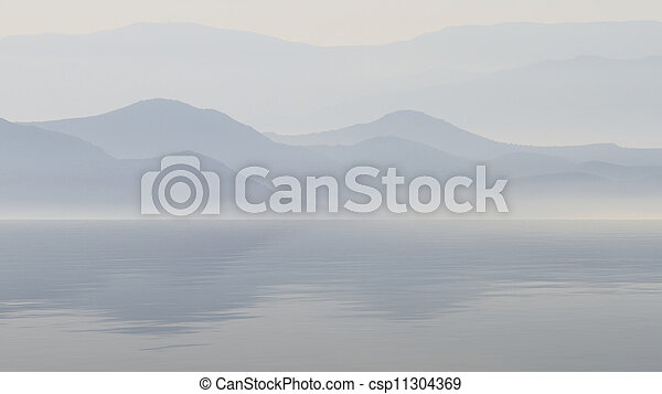 Scenic view of lake with mountain reflections - csp11304369