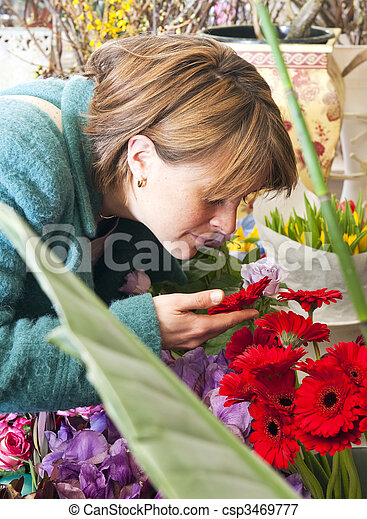 scent of a flower woman absorbing the scent of a flower whilst