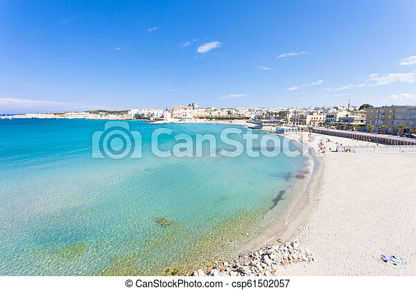 Otranto, Apulien - Relaxing at the beautiful beach bay of Otranto in Italy - csp61502057