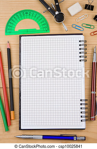school accessories and checked notebook on wood - csp10025841