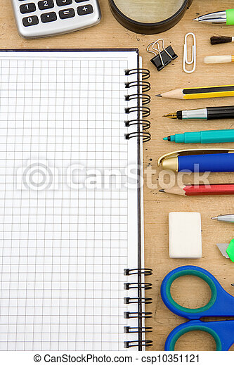 school accessories and checked notebook on wood - csp10351121