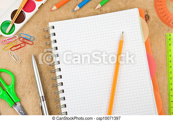 school accessories and checked notebook on wood - csp10071397