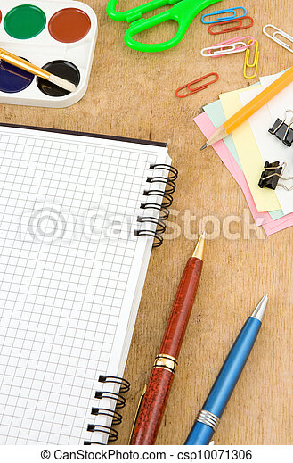 school accessories and checked notebook on wood - csp10071306