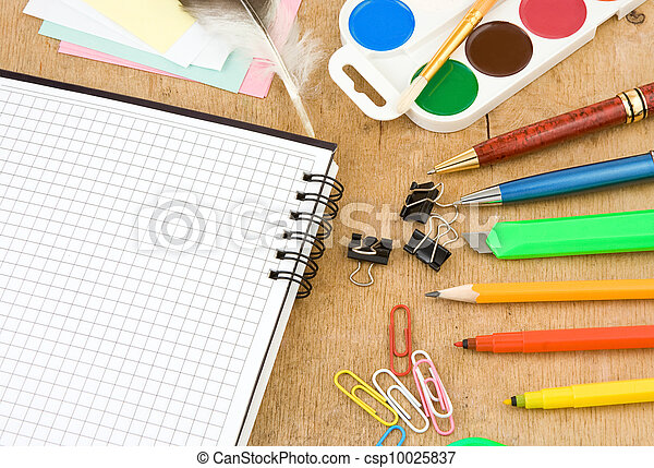 school accessories and checked notebook on wood - csp10025837
