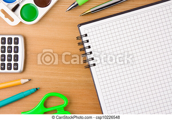 school accessories and notebook on wooden texture - csp10226548