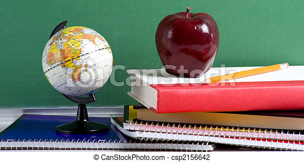 School Books a red Apple and a Globe - csp2156642