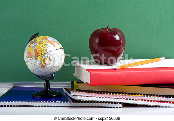 School Books a red Apple and a Globe - csp2156689