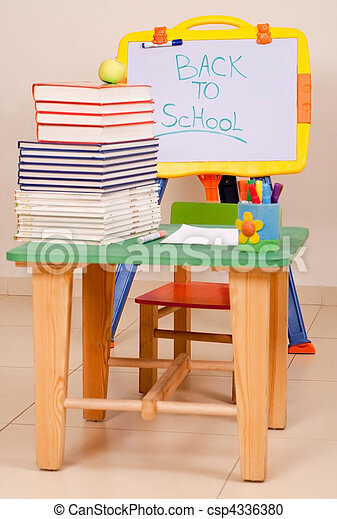 School books and apple on desk with sketchboard - csp4336380