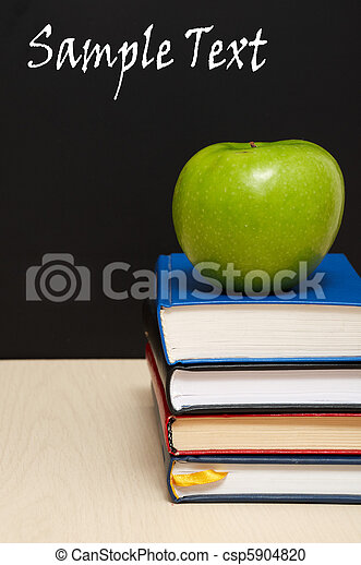School books with apple on desk - csp5904820