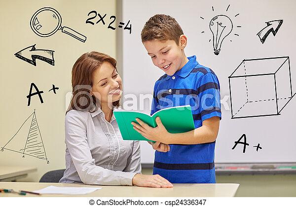 school boy with notebook and teacher in classroom - csp24336347