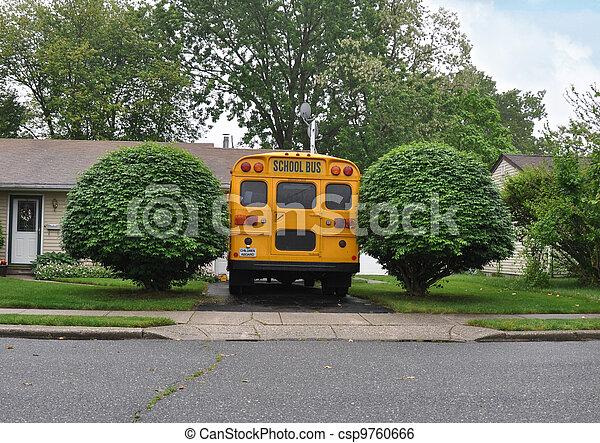 School Bus Parked in driveway - csp9760666