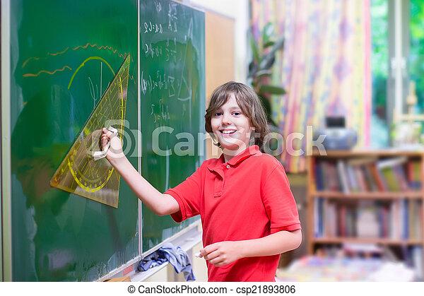 School child at math class - csp21893806