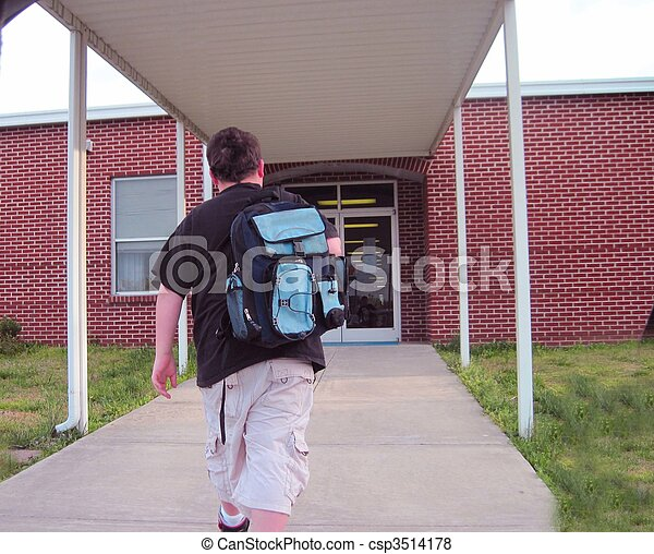 School Child Young Boy Walking Into School With Backpack