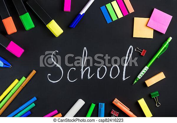 school is written in white chalk on the blackboard - csp82416223