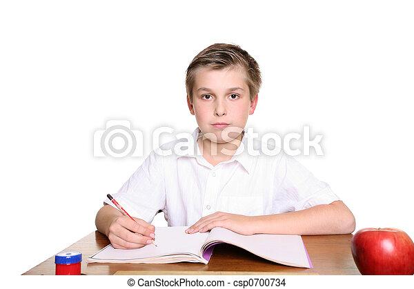 School pupil at desk - csp0700734