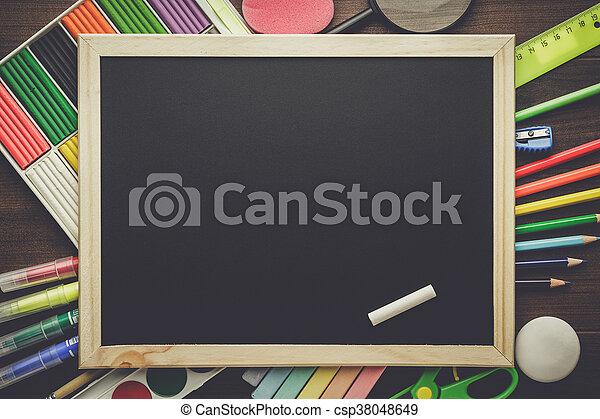 school supplies and blackboard - csp38048649