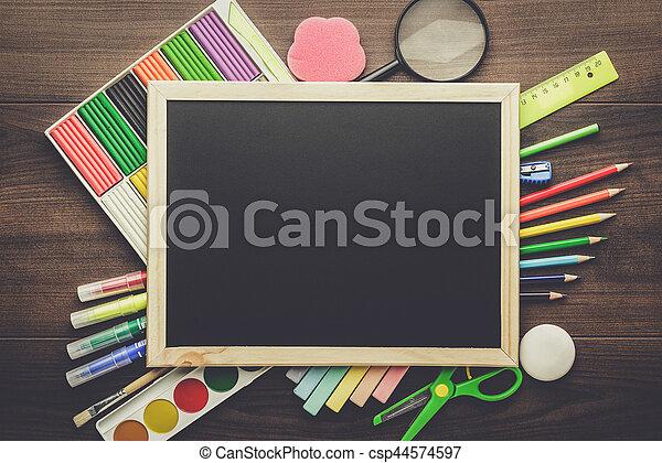 school supplies and blackboard - csp44574597