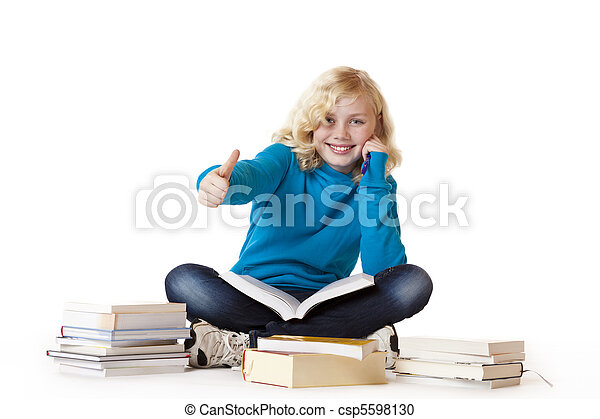 Schoolgirl sitting with books on floor and showing thumb up - csp5598130