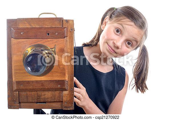 schoolgirl with old camera - csp21270922