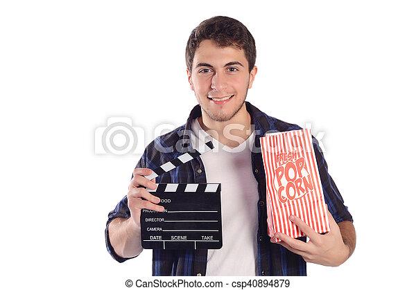 Mann mit Popcorn und Klepperbrett. - csp40894879