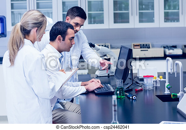 Science students working together in the lab - csp24462041
