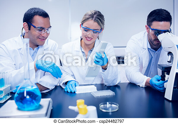 Science students working together in the lab - csp24482797