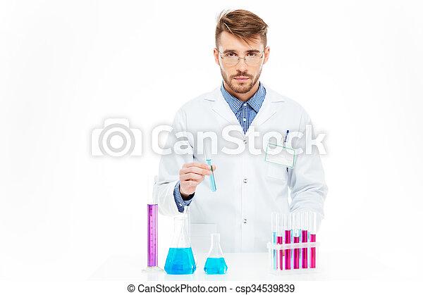 Scientist pouring chemicals - csp34539839