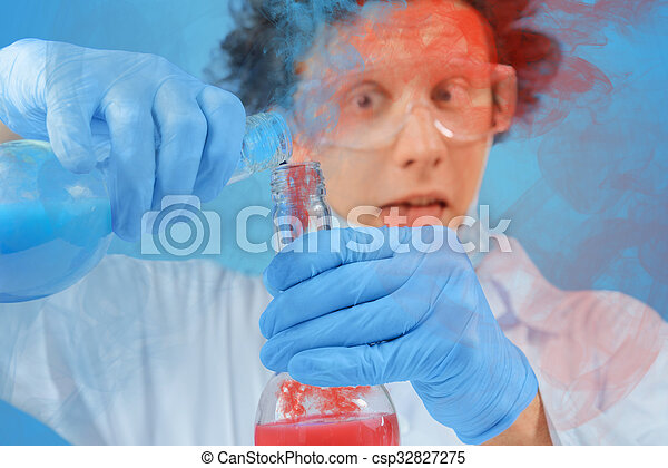 Scientist pouring liquid into flask - csp32827275
