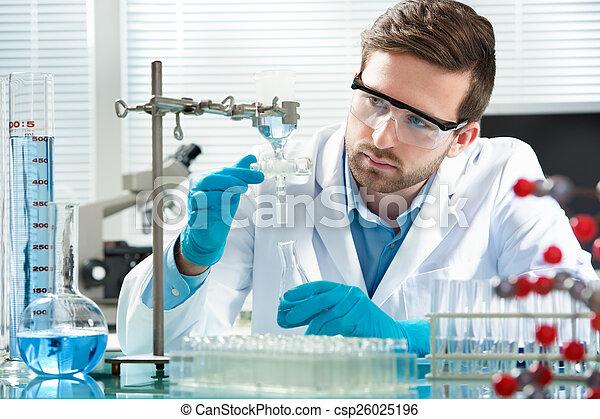 scientist working - csp26025196