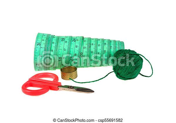 Scissors thread on white background - csp55691582