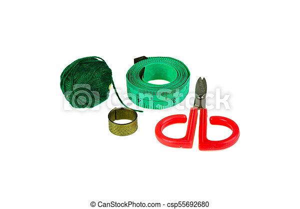 Scissors thread on white background - csp55692680