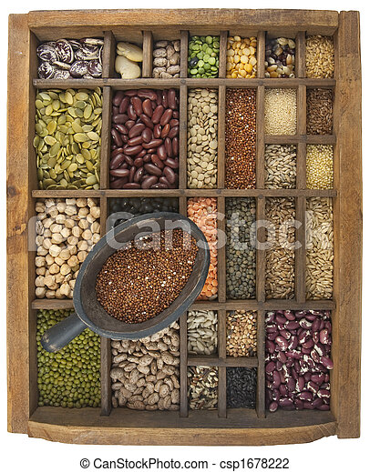scoop of red quinoa and a variety of beans, grain, seeds - csp1678222