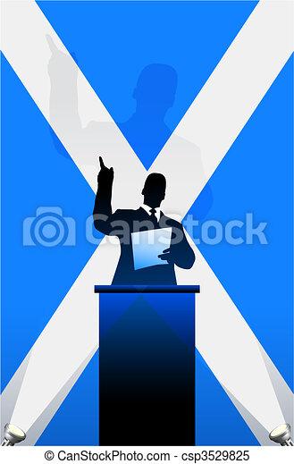 Scotland flag with political speaker behind a podium - csp3529825