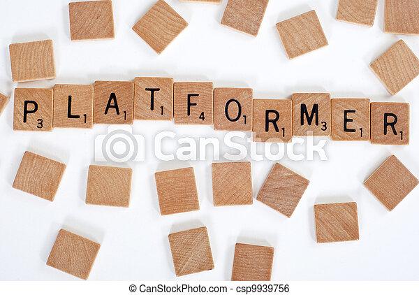 Scrabble tiles spell out 'Platformer' - csp9939756