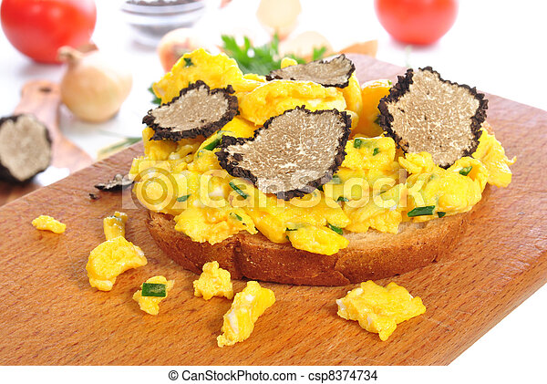 Scrambled eggs on bread with grated summer truffle - csp8374734