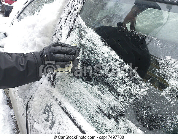 scraping snow and ice from the car windscreen  - csp17497780