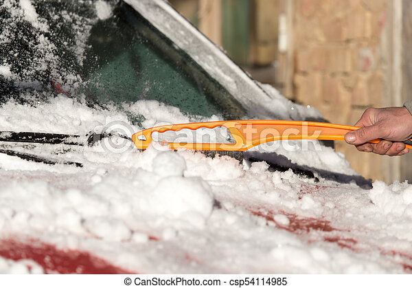 scraping snow from car winter - csp54114985