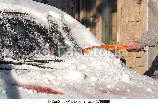 scraping snow from car winter - csp43796868