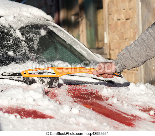 scraping snow from car winter - csp43988554