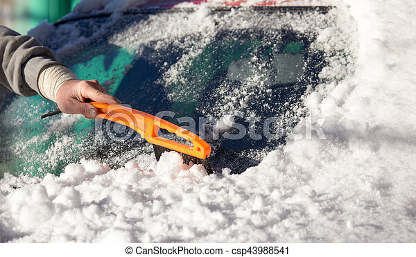 scraping snow from car winter - csp43988541