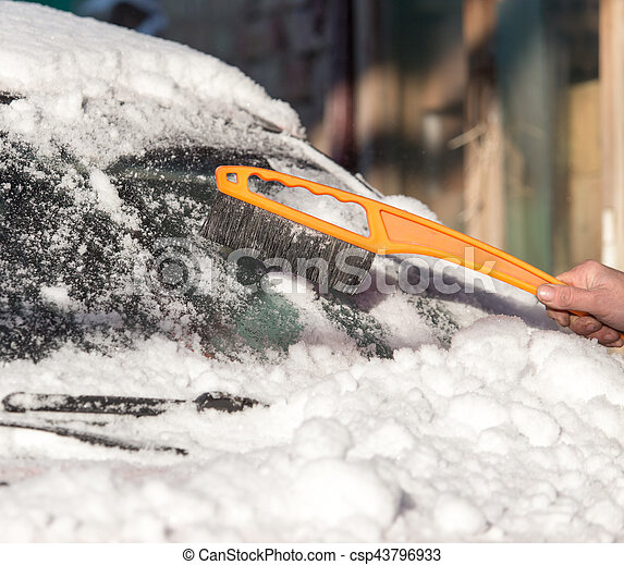 scraping snow from car winter - csp43796933