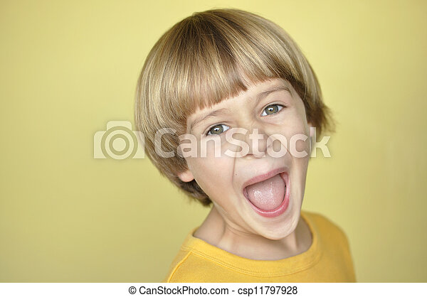 screaming child closeup of young blonde boy screaming on yellow