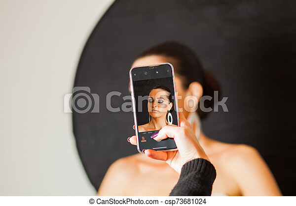Screened face of professional model with makeup - csp73681024