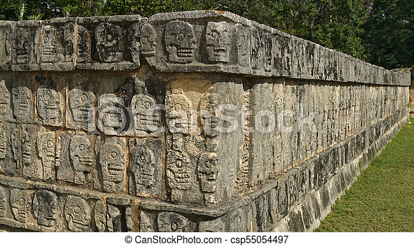 Scull carvings on a stone wall in the yucatan scull carvings on a