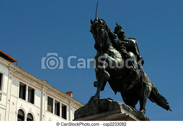 Sculpture of the horseman on the Venetian quay. Italy. - csp2233082