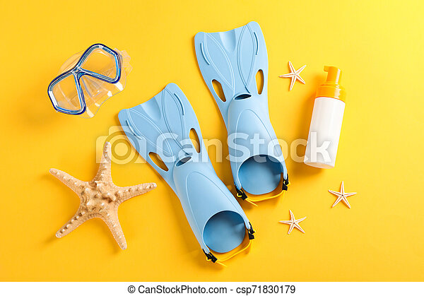 Sea vacation accessories on yellow background, top view - csp71830179