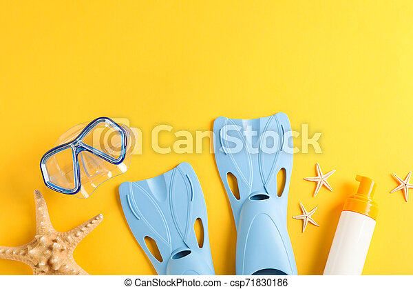 Sea vacation accessories on yellow background, top view - csp71830186