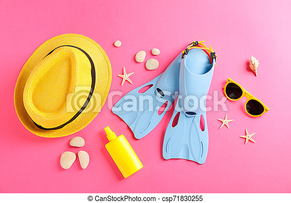 Sea vacation accessories on yellow background, top view - csp71830255
