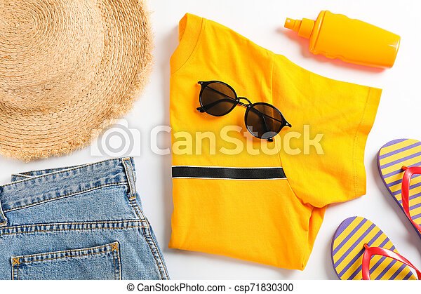Sea vacation accessories on yellow background, top view - csp71830300