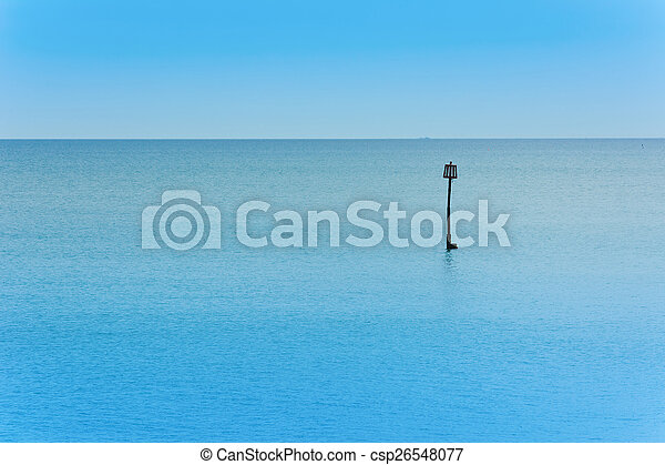 Sea view over calm water with blue sky. - csp26548077
